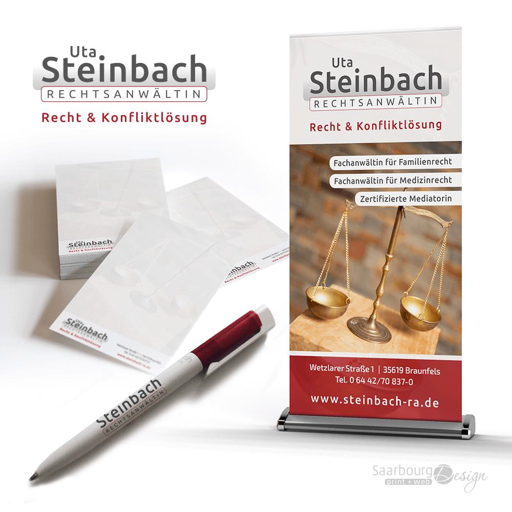 Darstellung von Schreibblock, Kugelschreiber und RollUp der Rechtsanwältin Uta Steinbach